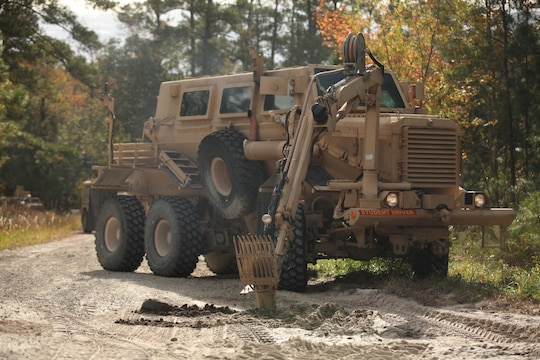MARINE CORPS BASE CAMP LEJEUNE, N.C. – The Buffalo, a mine-protected vehicle with a robotic arm with a claw and spike attached, uses its claw to search for more buried anti-tank mines during a route clearance course conducted for the Marines of Mobile Assault Company, 2nd Combat Engineer Battalion, 2nd Marine Division, aboard Marine Corps Base Camp Lejeune, Nov. 17. Throughout the day the instructors took note of their dispersion, radio communications, reaction time, how Husky was maneuvering and scanning for IEDs, how the unit set up security and many other details that will affect them when they deploy.