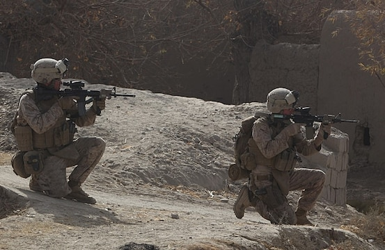 While in Sangin's southern area of operations, Marines scan the area before moving to an objective point, Dec. 23, 2010. The Marines of 2nd Platoon, India Company, 3rd Battalion, 5th Marine Regiment departed Forward Operating Base Jackson on an operation to secure a new patrol base in the area. Although the Marines were met with enemy fire, they quickly maneuvered, killed the enemy and seized their objective area.