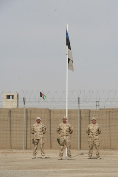 Soldiers with the Estonian Contingent stand before their flag during a farewell ceremony held aboard Camp Bastion, Helmand province, Afghanistan, May 9, 2014. This was the 17th and last Estonian Contingent to deploy to Afghanistan.