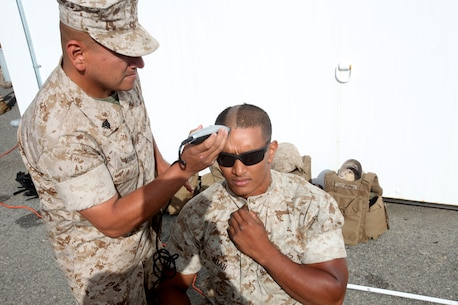 Sergeant Luis Manzo, platoon guide, 2nd Platoon, General Support Motor Transport Company, Combat Logistics Regiment 1, 1st Marine Logistics Group, shaves the head of Lance Cpl. Salauddin Miah, motor transport operator, 2nd Plt., GSMT Co., CLR-1, 1st MLG, aboard Camp Pendleton, Calif., May 5, 2014. Nineteen Marines with 2nd Plt., GSMT Co., CLR-1, 1st MLG shaved their heads to support their platoon sergeant's 16-year old cousin, Diego Romero, who was recently diagnosed leukemia.
