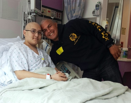 Staff Sgt. Juan Garcia, platoon sergeant, 2nd Platoon, General Support Motor Transport Company, Combat Logistics Regiment 1, 1st Marine Logistics Group, visits with his 16-year old cousin, Diego Romero, at University of California San Francisco Children's Hospital on April 19, 2014. Nineteen Marines with 2nd Plt. shaved their heads as an act of support to show Romero, that there is nothing wrong with being bald. Romero recently started receiving treatments for leukemia. After Romero's parents divorced, Garcia took on an important role in raising him, and they developed a father-son relationship.