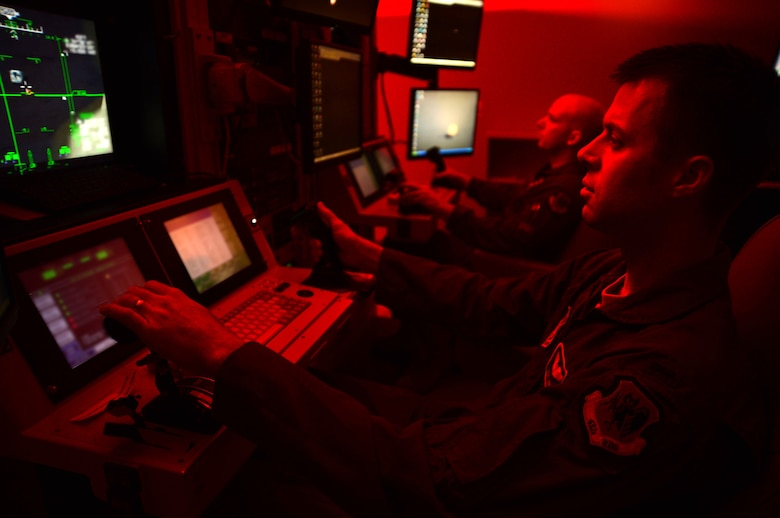 1st Lt. Kyle, 91st Attack Squadron pilot, and Tech. Sgt. Jason, 91st ATKS sensor operator, fly a simulated training mission on an MQ-9 Reaper at Creech Air Force Base, Nev., May 8, 2014. The 91st ATKS was recently awarded the 2013 Grover Loening Trophy, which is presented annually to the all-around outstanding aviation program in the nation excluding combat rescue and special operations (Last names withheld for security purposes). (U.S. Air Force photo by Staff Sgt. N.B./Released)