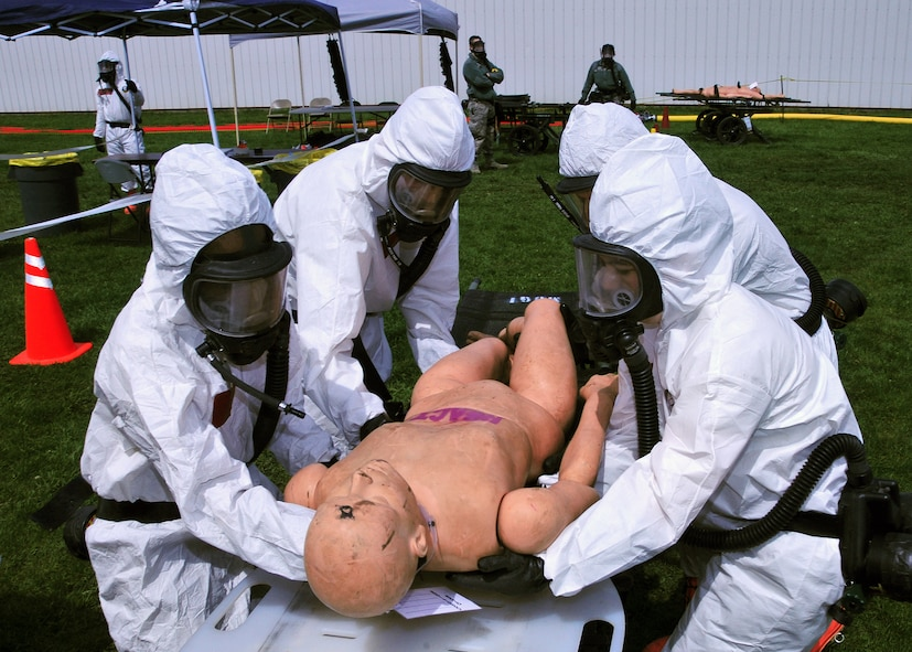 Wisconsin Army National Guard members perform mass decontamination of simulated casualties during an emergency preparedness exercise in Portage, Wisconsin, May 3, 2014. Columbia County Emergency Management, Divine Savior Hospital and the Wisconsin National Guard teamed up to practice the coordination and implementation of  their disaster response capabilities. (Air National Guard photo by Staff Sgt. Ryan Roth)