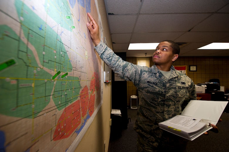 Staff Sgt. David Wallace III, 91st Security Forces Group plans and programs section, identifies possible threats and hazards to security force teams within the missile complex along, with crafting tactical defense plans for launch facilities and missile alert facilities at Minot Air Force Base, N.D., May 12, 2014. Wallace was named one of the 12 Outstanding Airmen of the Year. (U.S. Air Force photo/Senior Airman Brittany Y. Auld)