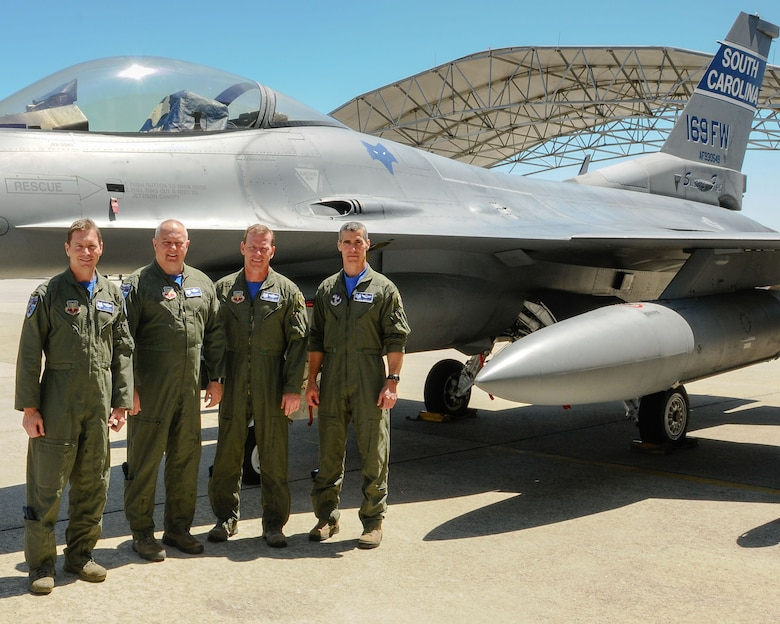 (left to right) U.S. Air Force Lt. Col. Scott Bridgers, Col. Michael Manning, Col. David Meyer and Col. Boris Armstrong, fighter pilots of the 169th Fighter Wing, pose for a group photo in front of the unit F-16 flagship at McEntire Joint National Guard Base, S.C., May 3, 2014. The four pilots combined have more than 17,178 flight hours in the F-16 fighter aircraft.  (U.S. Air National Guard photo by Tech. Sgt. Jorge Intriago/Released)