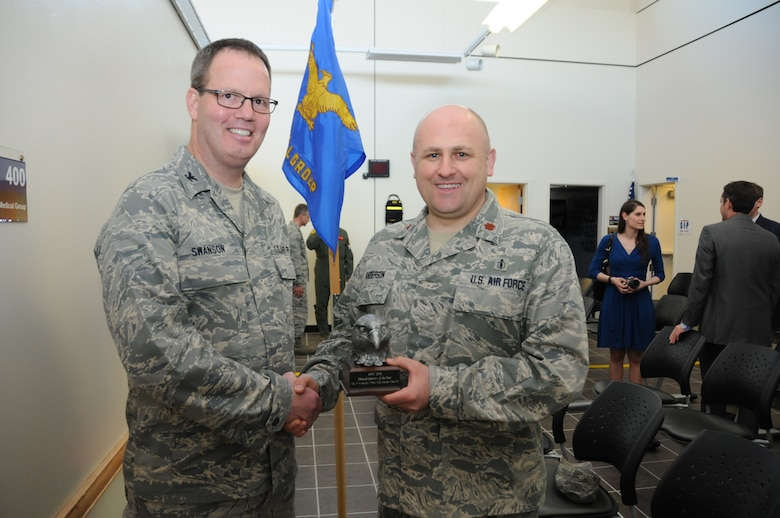 Maj. Paul Anderson, a 173rd Fighter Wing Dentist, accepts his award for top clinical dentist in the entire Air National Guard, April 6, 2014, at Kingsley Field, Ore. Anderson distinguished himself through a number of achievements including averaging 93-percent readiness across the board at Kingsley Field, and contributing to the wing's top medical readiness statistics in 2013. (U.S. Air Force photo by Tech. Sgt. Jefferson Thompson/released)