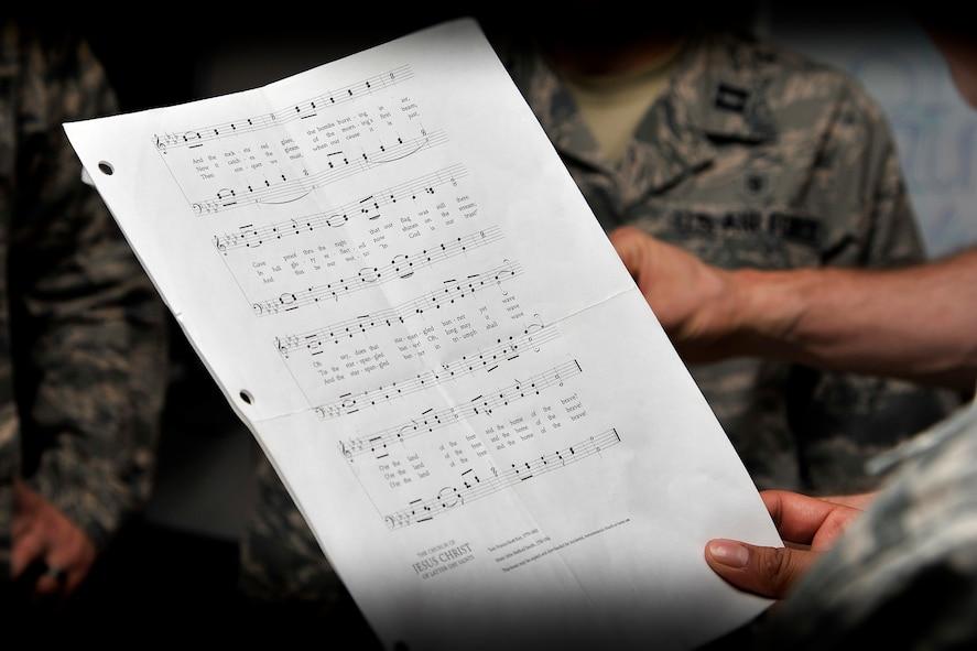 GOODFELLOW AIR FORCE BASE, Texas – A Patriotic Blue member holds sheet music at the Taylor Chapel here May 6. Patriotic Blue practices the national anthem at every practice so that they are always prepared to sing it at the drop of a hat. (U.S Air Force photo illustration/ Airman 1st Class Devin Boyer)