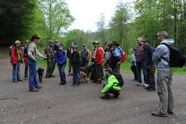 Jene Wilton, 606th Air Control Squadron Air Force engineering technical services and Boy Scouts Troop 161 assistant scout master, talks to a group of scouts and parents of troop 161 and 165 before a hike May 10, 2014, near Spangdahlem Air Base, Germany. The scouts cleaned more than 10 miles of trails for a community service project, and to raise awareness of scouting in the Eifel.  (U.S. Air Force photo by Airman 1st Class Dylan Nuckolls/Released)