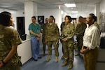 BAGRAM AIRFIELD, Afghanistan - Dr. Jonathan Woodson, Assistant Secretary of Defense for Health Affairs listens to a brief during his visit to the 455th Expeditionary Medical Group at the Craig Joint Theater Hospital, Bagram Airfield, Afghanistan May 8, 2014. Woodson is responsible for ensuring the effective execution of the Department of Defense medical mission and overseeing the development of medical policies, analyses, and recommendations to the Secretary of Defense and the Undersecretary for Personnel and Readiness, and issues guidance to DoD components on medical matters.  (U.S. Air Force photo by Master Sgt. Cohen A. Young)