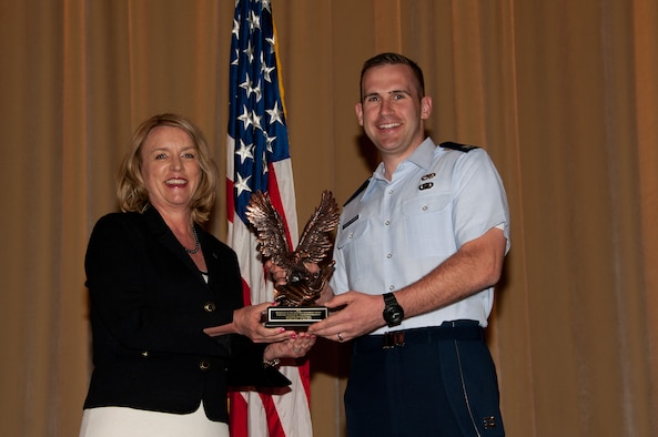 Secretary of the Air Force Deborah Lee James presents the 2014 Secretary of the Air Force leadership award to Squadron Officer School student Capt. Collin Christopherson, May 5, at Maxwell Air Force Base, Ala. The award is the Air Force's most prestigious award for leadership honoring exceptional performance in a professional military education setting. (U.S. Air Force photo/Bud Hancock)