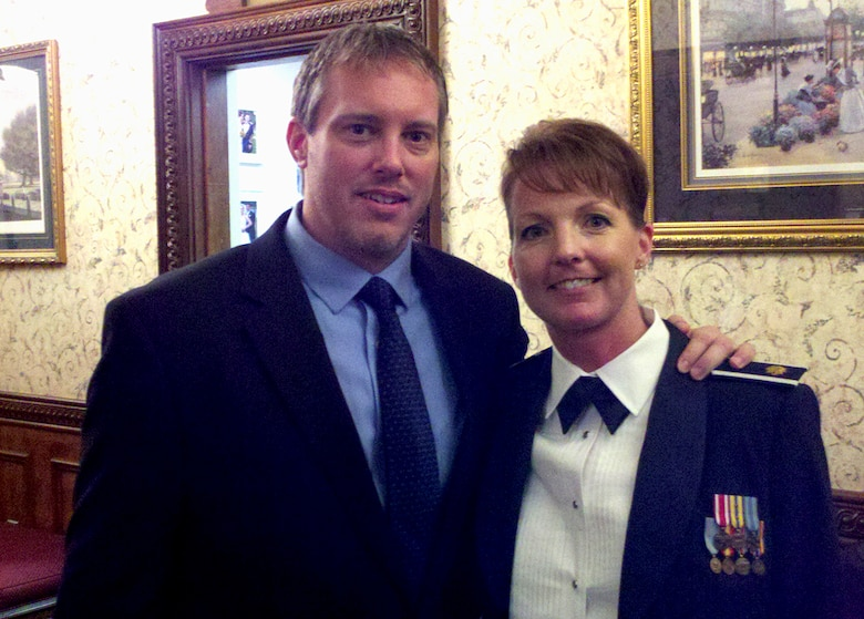 """Chris Pape, founder of """"Macho Spouse,"""" and his wife Maj. Dana Pape, Air Education and Training Command, Directorate of Manpower, Personnel and Services, Resources section chief, pose for a photo during an Air Force function. Chris is lauded in the citation for bringing a male, military spouse perspective into the spotlight as the founder of """"Macho Spouse,"""" an interactive online resource and educational video library. Macho Spouse videos capture life lessons from male spouses, advice from family counselors and career tips from military spouse career experts. (Courtesy photo)"""