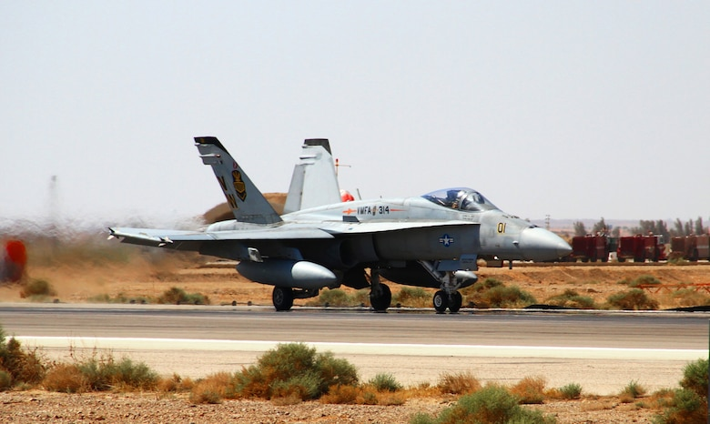 An F-18 Hornet from the U.S. Marine Corps Marine Air Group 50 taxis down a runway to join flying operations during Exercise Eager Tiger May 11, 2014, at an air base in northern Jordan. This exercise provides fighter pilots from the U.S. and Jordanian militaries a chance to conduct joint operations which enhance interoperability. (U.S. Air Force photo/Staff Sgt. Tyler McLain/Released)