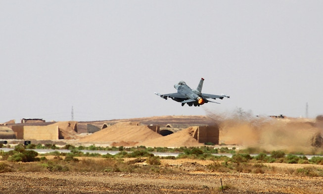 An F-16 Fighting Falcon from the 13th Fighter Squadron at Misawa Air Base, Japan, takes off during Exercise Eager Tiger May 11, 2014, at an air base in northern Jordan. This multi-national exercise allows fighter pilots to collaborate and practice their tactics and techniques. (U.S. Air Force photo/Staff Sgt. Tyler McLain)