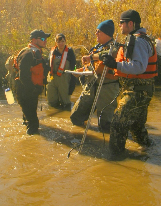 ALBUQUERQUE, N.M., -- Corps staff work with a U.S. Geological survey team to map Rio Grande silvery minnow habitat in support of endangered species management and recovery.  The silvery minnow is listed as an endangered species. Photo by Michael Porter, Nov. 9, 2011.