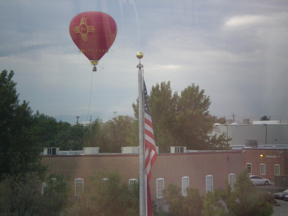 ALBUQUERQUE, N.M., -- One of the hundreds of hot air balloons from the Albuquerque Balloon Festival floats near the District Office. Photo by Douglas Bailey, Oct. 4, 2011.