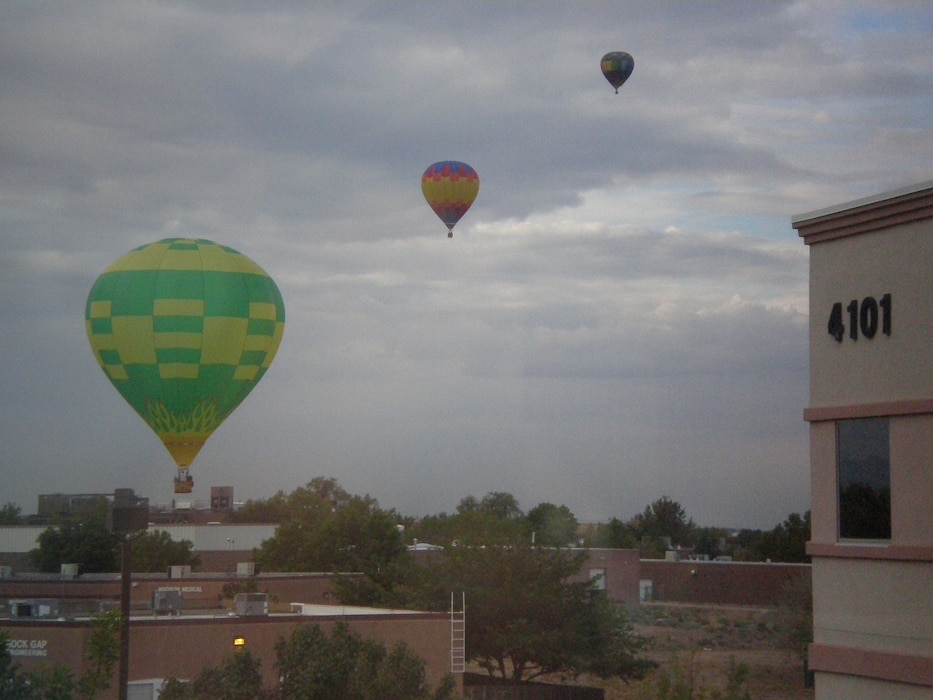 ALBUQUERQUE, N.M., – Three of the hundreds of hot air balloons from the Albuquerque Balloon Festival float near the District Office. Photo by Douglas Bailey, Oct. 4, 2011.