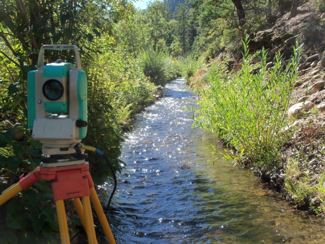 A Nikon total station used for surveying. The view is upstream of the Acequia San Juan Nepomuceno near Penasco, N.M. photo by Gary Edwards, Sept. 23, 2010.