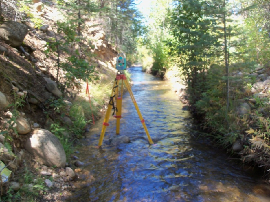 """Surveying equipment looking downstream on the San Juan Nepomuceno Acequia, near Penasco, N.M."" Photo by Gary Edwards, Sept. 23, 2010."