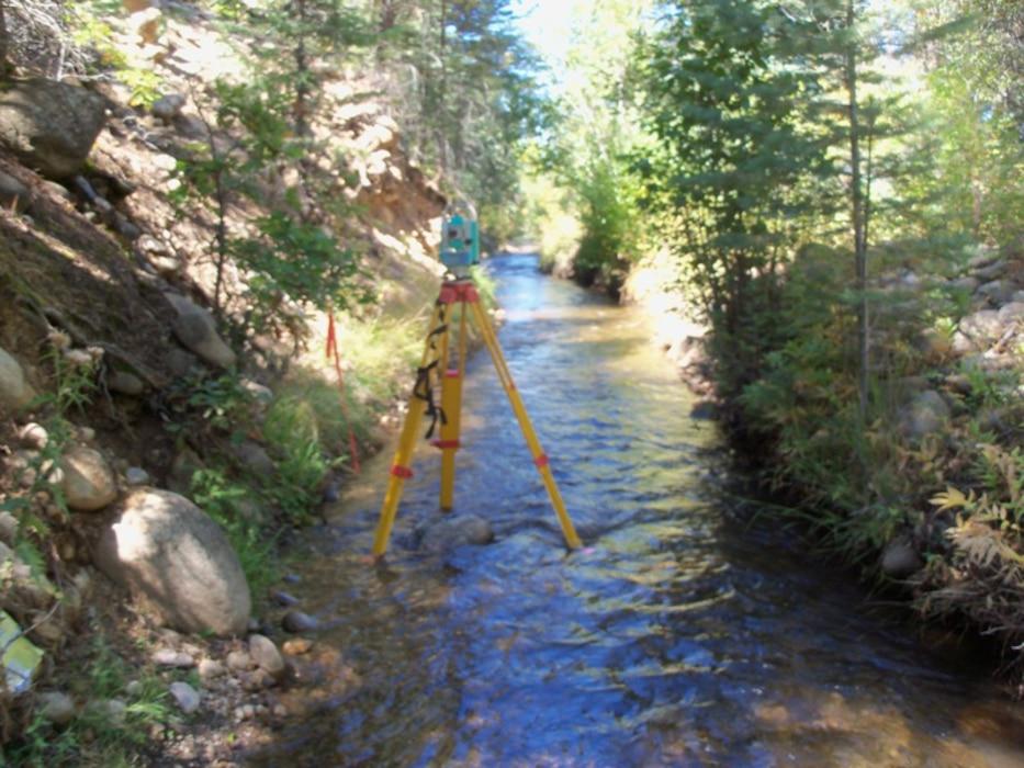 """Surveying equipment looking downstream on the San Juan Nepomuceno Acequia, near Penasco, N.M."" Photo by Gary Edwards, Sept. 23, 2010."