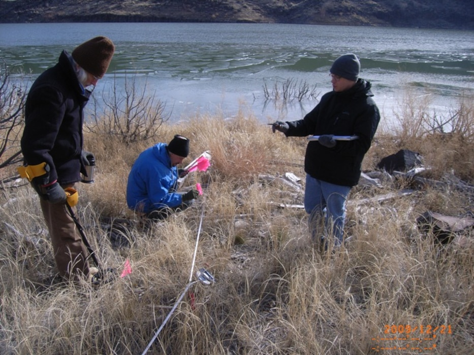 "COCHITI LAKE, N.M., -- Albuquerque District archaeologists locate and measure artifact displacement from Cochiti Lake wave action as part of the Cochiti Deviation Artifact Movement Study.  The 5-year study is tracking the movement of ""placed artifacts"" due to lake water storage/wave action.
