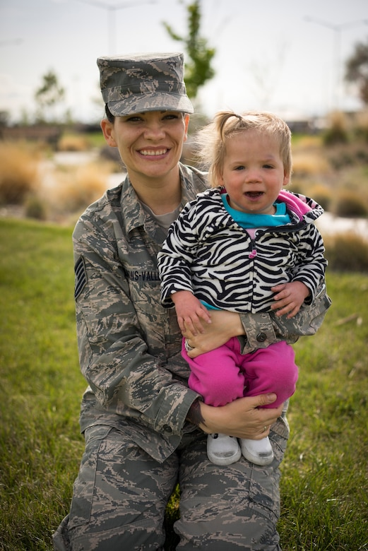Tech. Sgt. Jamie Meadows-Valley, 366th Aerospace Medicine Squadron, poses for a photo with her newly adopted daughter Oleksandra at Mountain Home Air Force Base, Idaho, on May 6, 2014. (U.S. Air Force photo/Tech. Sgt. Samuel Morse)