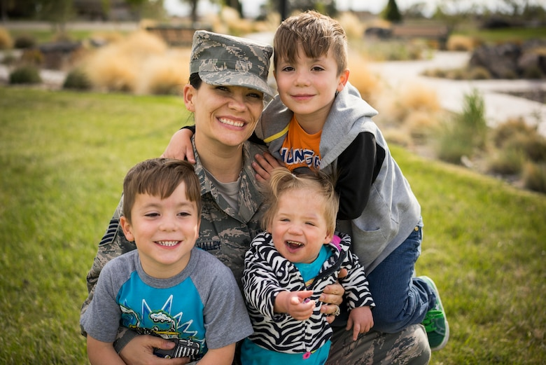Tech. Sgt. Jamie Meadows-Valley, 366th Aerospace Medicine Squadron, poses for a photo with her twin sons, Wolfgang and Jaeger, and her newly adopted daughter Oleksandra at Mountain Home Air Force Base, Idaho, on May 6, 2014. (U.S. Air Force photo/Tech. Sgt. Samuel Morse)
