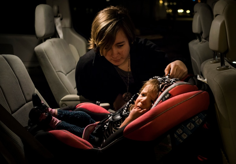 Jewel Valley comforts her sister, Oleksandra, at a friend's house in Boise, Idaho. Just like many toddlers, Oleksandra still doesn't like riding in her car seat. (U.S. Air Force photo/Tech. Sgt. Samuel Morse)