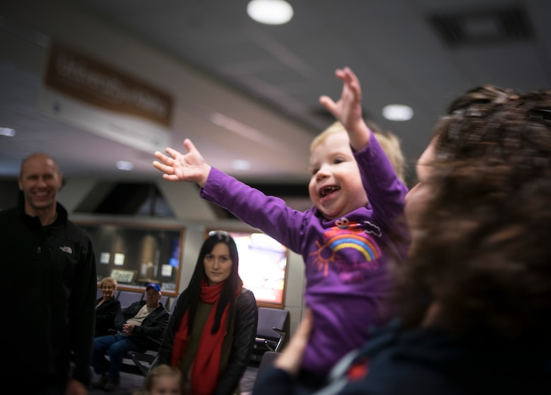Oleksandra Valley, 2, revels in being passed from person to person after arriving at Boise Airport in Boise, Idaho. This was Oleksandra's first time meeting the friends of the Valley family. (U.S. Air Force photo/Tech. Sgt. Samuel Morse)