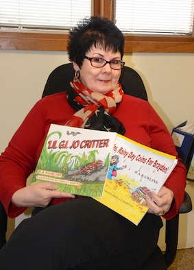 """Brenda Rawlins is a government worker by day, children's author by night. Her latest book, """"Lil' G.I. Jo Critter,"""" is based on the horned lizards that live at Tinker.  (Air Force photo by Kelly White)"""