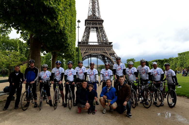 The riders and support team pause for a group photo after finishing the Eifel-to-Eiffel bicycle ride in Paris, May 10, 2014. The riders cycled approximately 290 miles traveling from Spangdahlem Air Base, Germany to Paris. (U.S. Air Force photo by Airman 1st Class Kyle Gese/Released)
