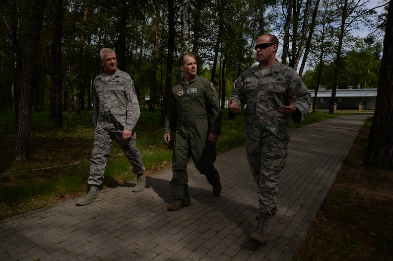U.S. Air Force Col. Robert Winkler, 52nd Operations Group commander, center, and Chief Master Sgt. Bruce Zahn, 52nd OG chief enlisted manager, left, listen as Master Sgt. Mark Dawkins, Detachment 1, 52nd Operations Group maintenance operations liaison, right, discusses maintenance operations while walking to the flightline at Łask Air Base, Poland, May 7, 2014. Dawkins serves with nine other personnel assigned to Detachment 1, which aims to strengthen interoperability between the U.S. and Polish air forces.   (U.S. Air Force photo by Staff Sgt. Joe W. McFadden/Released)