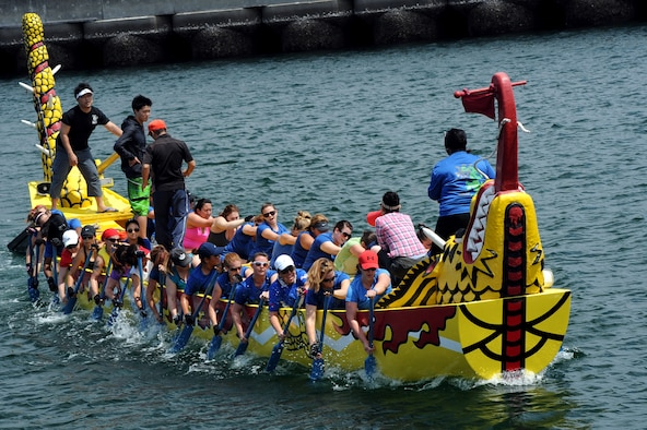 Members of the Kadena women's dragon boat team learn to row their boat in unison during a practice session in Naha City, Okinawa, Japan, April 12, 2014. The team's coach, Comica Middleton, bangs a metal drum at an even tempo to keep the team members in sync. (U.S. Air Force photo by Airman 1st Class Zade C. Vadnais)