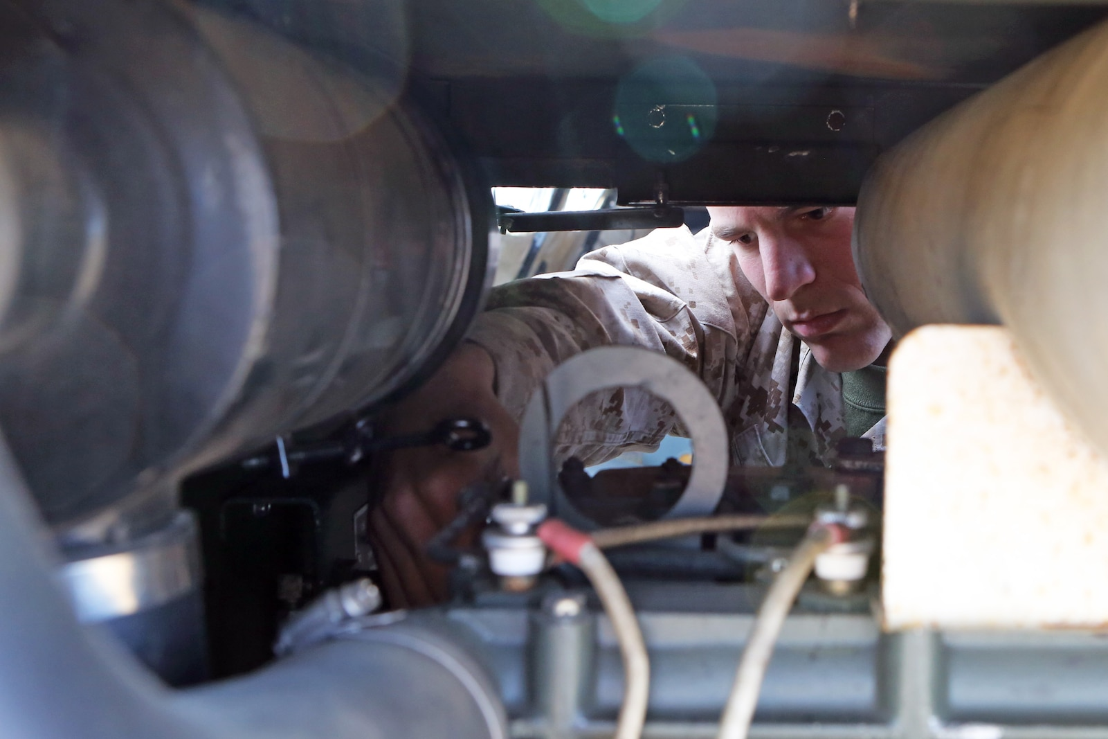 Sergeant Andrew Heins, a 22-year-old maintenance mechanic, Maintenance Detachment, Combat Logistics Battalion 15, 1st Marine Logistics Group repairs a generator during the battalion's first field training exercise of the year at Red Beach  aboard Camp Pendleton, Calif., May 6-10, in preparation for pre-deployment training with the 15th Marine Expeditionary Unit this fall. The exercise allowed CLB-15 to practice procedures and protocols they will apply while acting the 15th MEU's primary logistical support element during its deployment early next year. Providing this support to the MEU allows it to focus on its chief objective as a crisis response force, ready to respond to disaster or humanitarian relief operations.