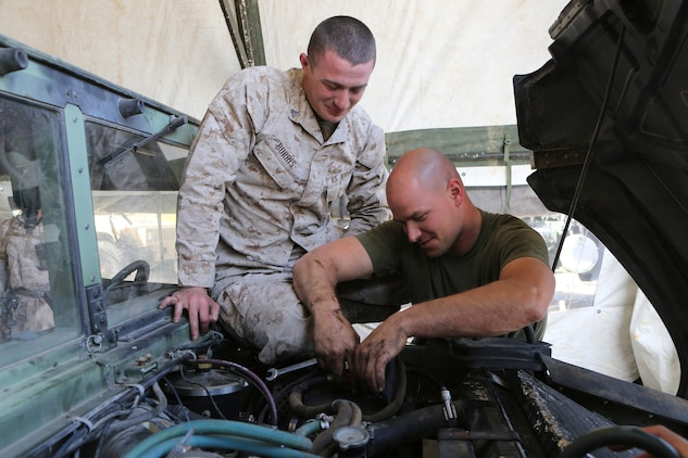Corporal Cody Burris, left, a 22-year-old of Amelia, Ohio, and Sgt. Rodney Gleisner, right, a 28-year-old of Watertown, N.Y., both maintenance mechanics, Maintenance Detachment, Combat Logistics Battalion 15, 1st Marine Logistics Group, repair a Humvee during the battalion's first field training exercise of the year at Red Beach aboard Camp Pendleton, Calif., May 6-10, in preparation for pre-deployment training with the 15th Marine Expeditionary Unit this fall. The exercise allowed CLB-15 to practice procedures and protocols they will apply while acting the 15th MEU's primary logistical support element during its deployment early next year. Providing this support to the MEU allows it to focus on its chief objective as a crisis response force, ready to respond to disaster or humanitarian relief operations.