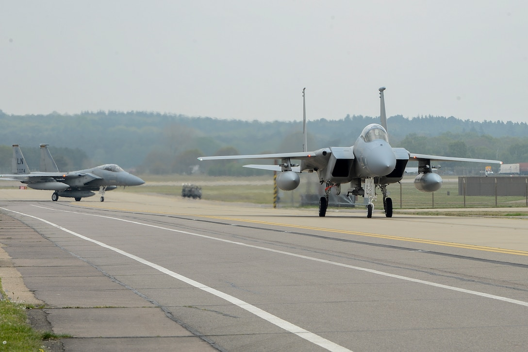 Two F-15C Eagles taxi down the flightline after returning from the 48th Fighter Wing's participation in Baltic Air Policing May 1, 2014, at Royal Air Force Lakenheath, England. The U.S. Air Force's 48th Air Expeditionary Group handed over the reins of NATO's BAP mission to the air forces of Poland and the United Kingdom during a ceremony at Šiauliai Air Base, Lithuania, April 30, 2014. (U.S. Air Force photo/Airman 1st Class Trevor T. McBride)