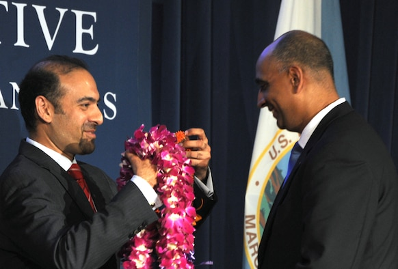 A President's Advisory Commission member presents a lei to Lt. Col. Ravi Chaudhary May 6, 2014, during the Asian American and Pacific Islanders Heritage Month opening ceremony in Washington, D.C. During the ceremony, Chaudhary was sworn in as a member of the President's Advisory Commission on AAPIs. As a commission member, Chaudhary is charged with working to improve the quality of life for AAPIs through increased participation in and access to federal programs. Chaudhary is an Air Force District of Washington executive officer. (U.S. Air Force photo/Master Sgt. Tammie Moore)