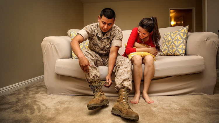 Corporal Alberto Perez III, left, administrative specialist, 15th Marine Expeditionary Unit, sits next to his wife, Carla Jimenez, as he takes his boots off after work aboard Camp Pendleton, Calif., May 8, 2014. Perez, 22, is from Burbank, Calif. (U.S. Marine Corps photo by Cpl. Emmanuel Ramos/Released)