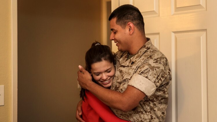 Corporal Alberto Perez III, right, administrative specialist, 15th Marine Expeditionary Unit, holds his wife, Carla Jimenez, as they discuss decorations for their unborn child's room aboard Camp Pendleton, Calif., May 8, 2014. Perez, 22, is from Burbank, Calif. (U.S. Marine Corps photo by Cpl. Emmanuel Ramos/Released)