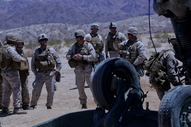 Ryan Forbes, second from left, a 13 year-old native of San Diego, talks with Marines about the M777 lightweight howitzer  at Marine Corps Air Ground Combat Center Twentynine Palms May 13, 2014. Forbes was an honorary Marine for a day with Lima Battery, 3rd Battalion, 11th Marine Regiment and learned about the weapon systems and lifestyles of the Marines. He was accompanied by his parents and brother, and attended training with the battery, participating in drills and eating lunch with a section. Forbes has wanted to join the military for several years and spends time learning about the different branches. He was diagnosed with medulloblastoma, a form of brain cancer in January. His diagnosis and current treatment for medullablastoma hasnt hampered his enthusiasm for the military.