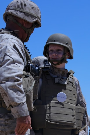 Ryan Forbes, a 13 year-old native of San Diego, talks with Marines of Lima Battery, 3rd Battalion, 11th Marine Regiment, about the weapon systems and lifestyles of the Marines at Marine Corps Air Ground Combat Center Twentynine Palms May 13, 2014. Forbes was an honorary Marine for a day with the battalion. He was accompanied by his parents and brother, and attended training with the battery, participating in drills and eating lunch with a section. Forbes has wanted to join the military for several years and spends time learning about the different branches. He was diagnosed with medulloblastoma, a form of brain cancer in January. His diagnosis and current treatment for medullablastoma hasnt hampered his enthusiasm for the military.