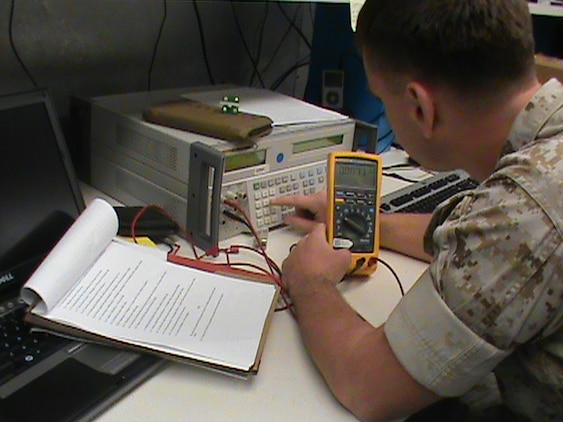 A Marine calibrates a multimeter, a device used to measure properties of electricity such as voltage, current and resistance, using the multimeter workstation standards from the Expeditionary Test, Diagnostic and Measurement Equipment Maintenance System. The ETMS lets Marines calibrate test equipment in 28 different test areas.