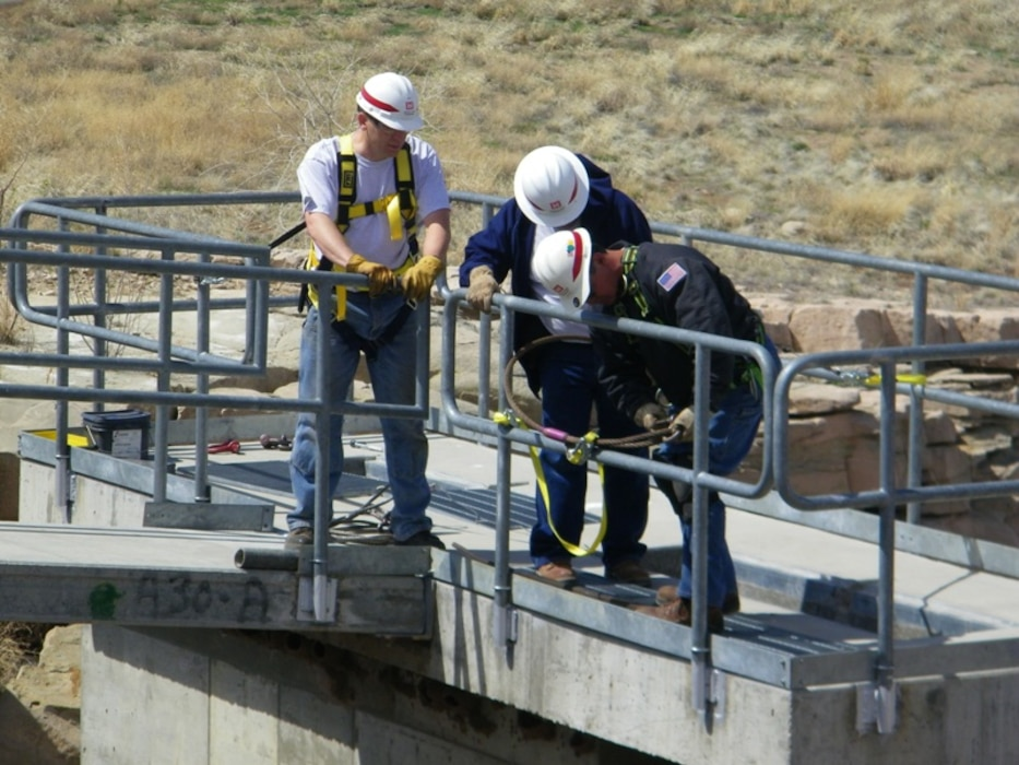 CONCHAS DAM, N.M., -- Corps' employeess performing a periodic inspection of the dam's irrigation headworks. Photo by Antonio Urquidez, April 13, 2010.