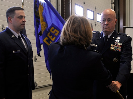 JOINT BASE ELMENDORF-RICHARDSON, Alaska -- Lt. Col. Jack Evans, in-coming commander of the 176 Civil Engineer Squadron, ceremoniously accepts the squadron flag  here April 13, 2014, from 176 Mission Support Group commander, Col. Patti Wilbanks. The 176 CES members recieved their newest commander and bid farewell to their previous commander, Lt. Col. Ed Soto, of 17 years. U.S. Air National Guard photo by Staff Sgt N. Alicia Halla/ Released