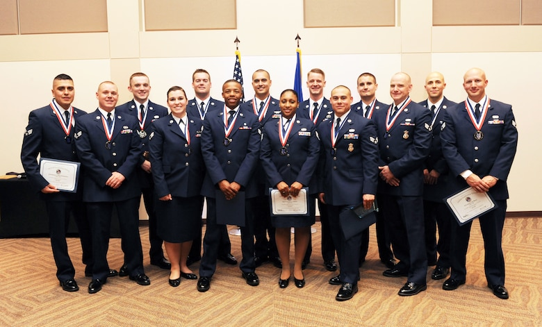 Buckley Airman Leadership School Class 14-D stand together after their graduation May 9, 2014, at the Leadership Development Center on Buckley Air Force Base, Colo. This graduation represents an important part of the enlisted force professional military education, teaching valuable skills required for supervisors. (U.S. Air Force photo by Airman Emily E. Amyotte/Released)
