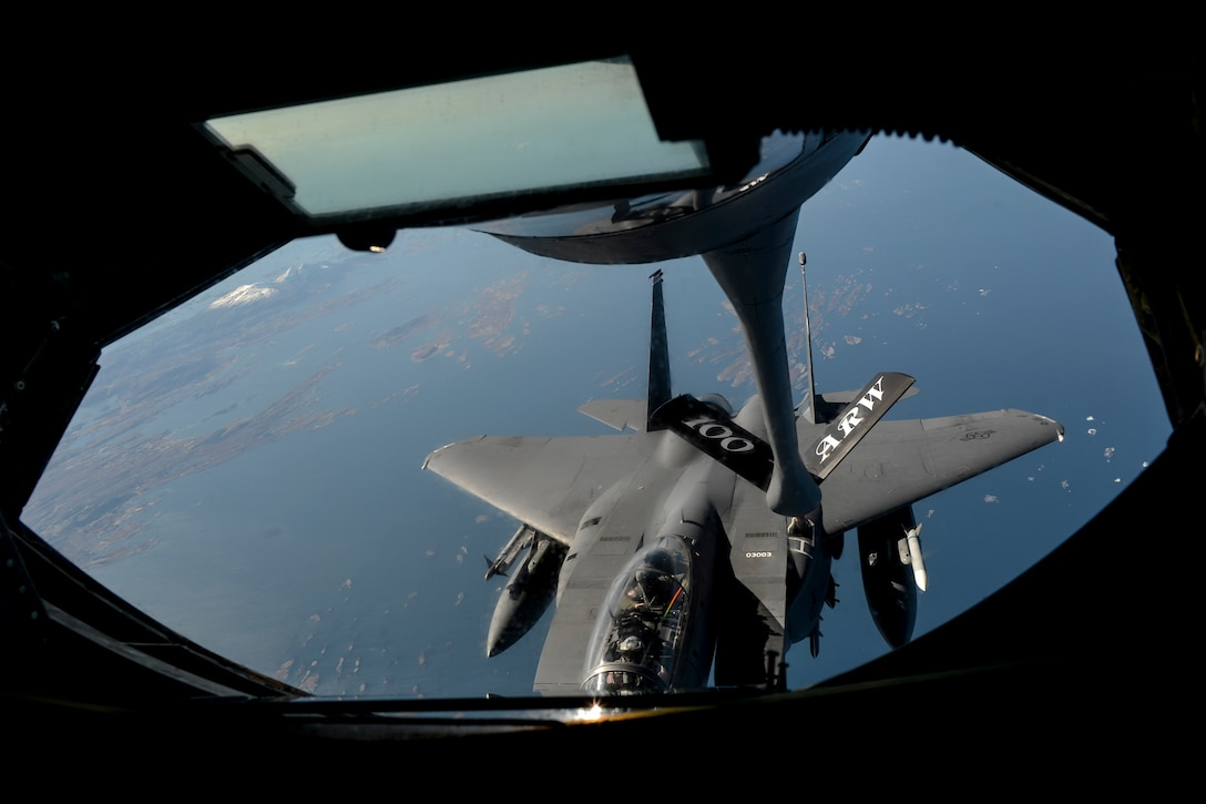 A U.S. Air Force F-15E Strike Eagle, assigned to the 48th Fighter Wing, refuels from a KC-135R Stratotanker May 6, 2014, en route to a Nordic Defense Cooperation exercise with air forces from Norway, Sweden and Finland. The exercise strengthened the U.S. Air Force's interoperability with NATO allies and regional partners through combined training. (U.S. Air Force photo by Airman 1st Class Trevor T. McBride/Released)
