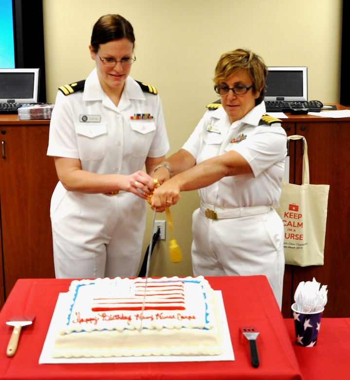 Lt. Erin Curtis and Capt. Alice Cagnina, Naval Health Clinic Charleston nurses, cut a cake in honor of the Navy Nurse Corps birthday during a celebration May 13, 2014 at NHCC on Joint Base Charleston.  President Theodore Roosevelt signed the Naval Appropriations Bill authorizing the establishment of the Nurse Corps as a unique staff corps of the Navy May 13, 1908. (U.S. Photo by Petty Officer 1st Class Josh Gutierrez)