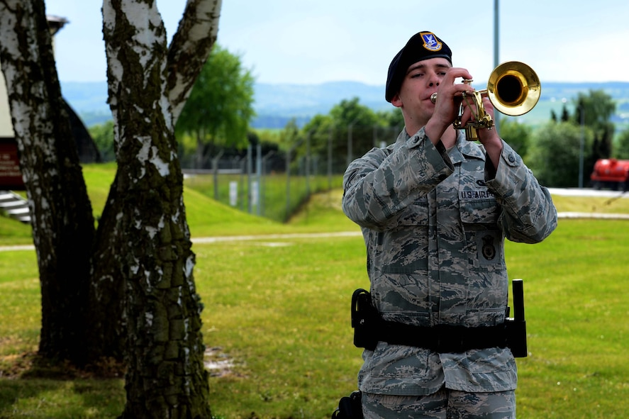 U.S. Air Force Airman 1st Class Dyllan Lewis, 52nd Security Forces Squadron entry controller, plays taps during a National Police Week retreat ceremony at Spangdahlem Air Base, Germany, May 12, 2014. The other bases events included a ruck march, jail and bail, defender decathlon and a security forces display. (U.S. Air Force photo by Airman 1st Class Kyle Gese/Released)