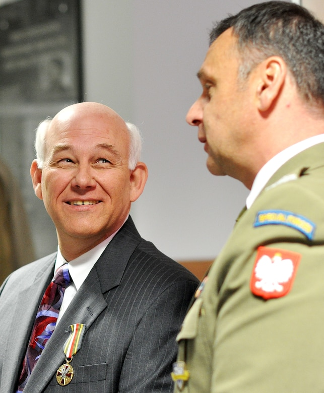 Roy Vaughn (left) received the Polish Armed Forces Medal May 6 in recognition for his contributions to enhancing Poland's special operations capabilities. Polish Air Force Col. Piotr Gastal (right) presented the medal in a ceremony in Warsaw. (Polish Armed Forces photo)