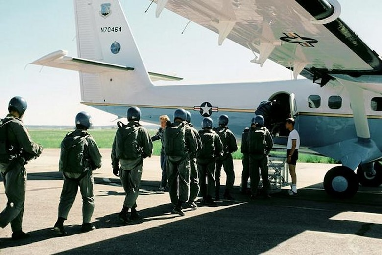 Wings of Blue team boarding a plane in the 1990's. (Courtesy Photo)