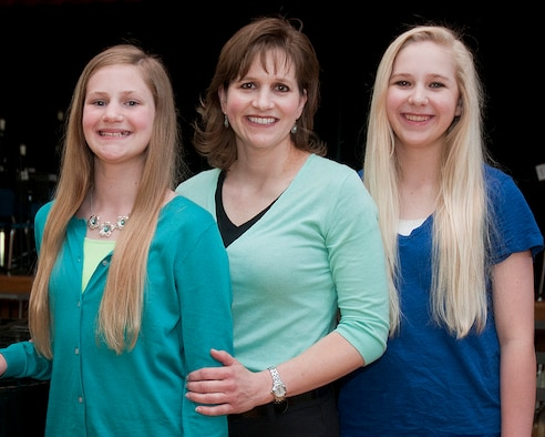 "Cathy McSwain and her two daughters, Emily (right) and Allison (left), were notified recently that they won the family act of the Air Force Worldwide Family and Teen Talent Contest. The McSwain family performed ""Summertime"" from ""Porgy and Bess"" October 2013, during the local competition that was recorded and forwarded to the Air Force-level ""You Got Talent"" contest. (U.S. Air Force photo/Mark Wyatt)"